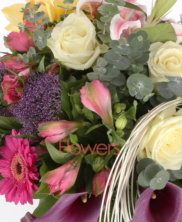1 pink lily, 3 white roses, 1 yellow cymbidium, 3 pink gerbera, 3 pink alstroemeria, 2 green anthurium, 3 purple callas,3 purple trachelium, greenery