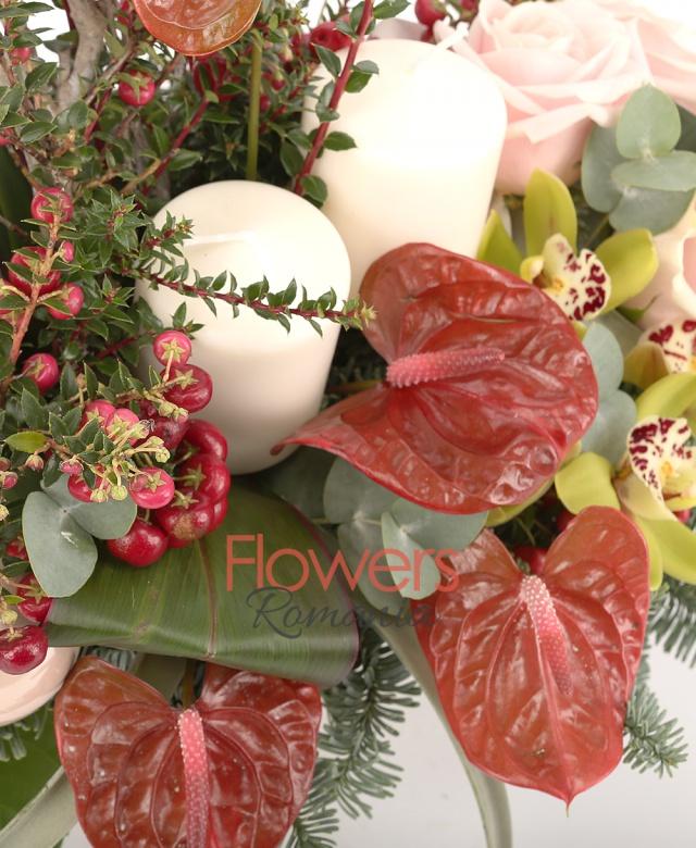 3 pink roses, 4 red anthurium, 5 red hypericum, 1 green cymbidium, 3 globes, 2 candles, tillandsia, nobilus fir, greenery