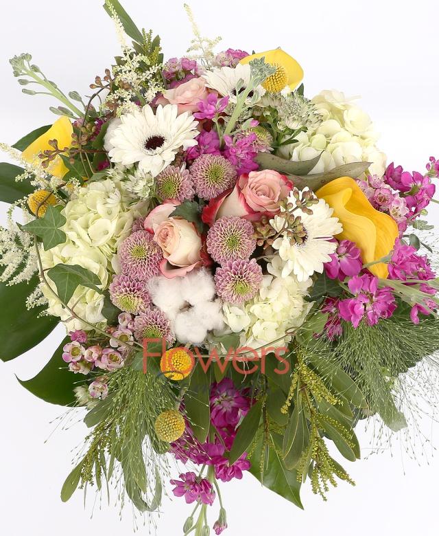 3 white hydrangeas, 3 pink roses, 3 yellow callas, 3 pink santini, 4 pink matthiola, 3 white gerbera, 3 craspedia, cotton, 5 astilbe, panicum, waxflower, greenery