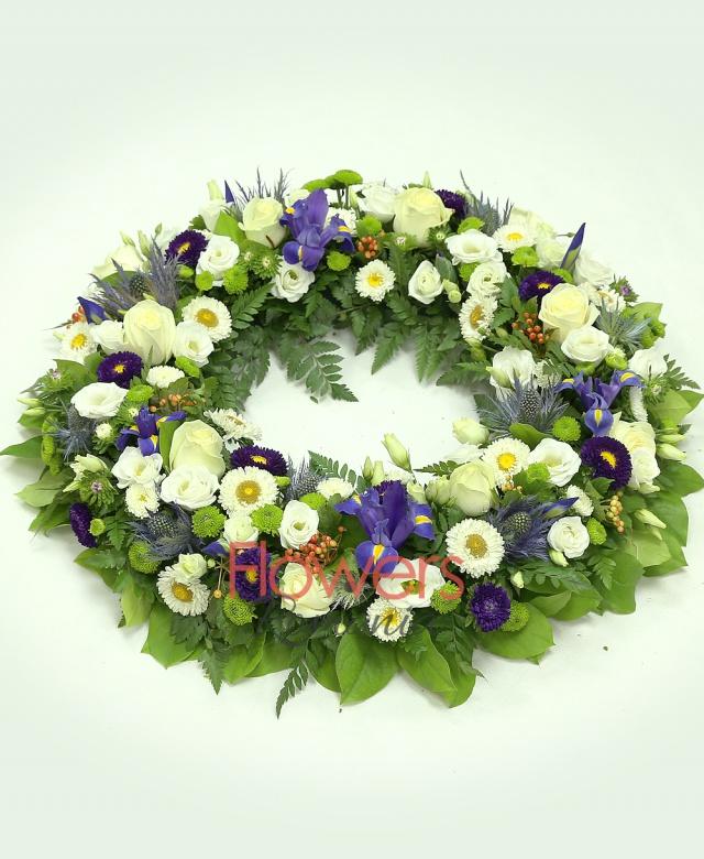 10 white roses, 10 purple iris, 7 white lisianthus, 5 eryngium, 8 green santini, 5 white chrysanthemums, 8 hypericum, greenery