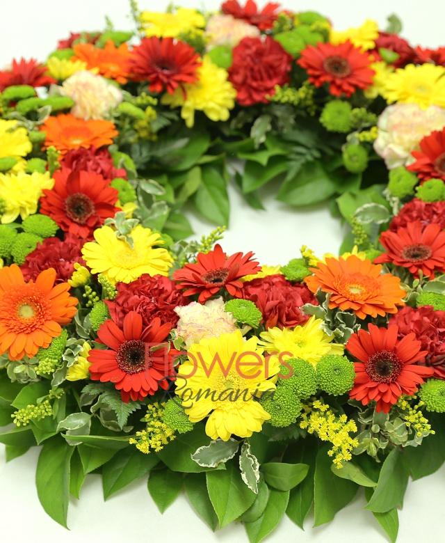 12 red gerberas, 10 yellow gerbera, 5 orange gerbera, 10 pink carnations, 10 red carnations, 4 yellow chrysanthemums, 8 green santini, solidago, greenery
