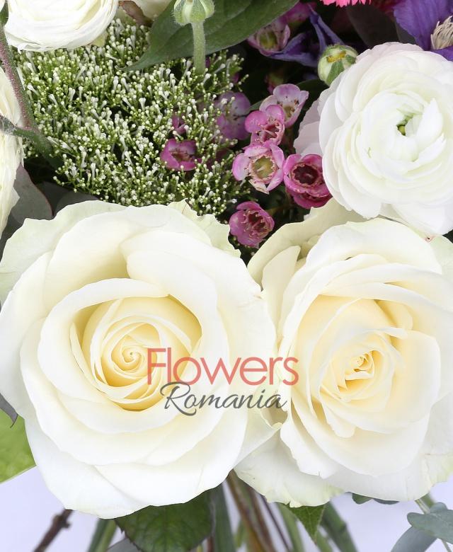 5 white roses, 10 white ranunculus, 3 carnations, 2 green anthurium, waxflower, 2 anigozanthos, 3 white trachelium, 3 clematis, greenery