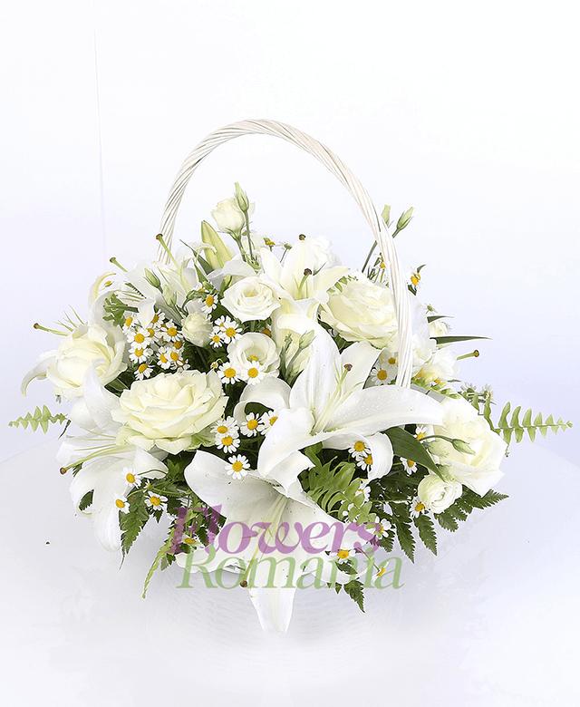 2 white lilies, 5 white lisianthus, 5 white roses, 5 white freesias, chamomile