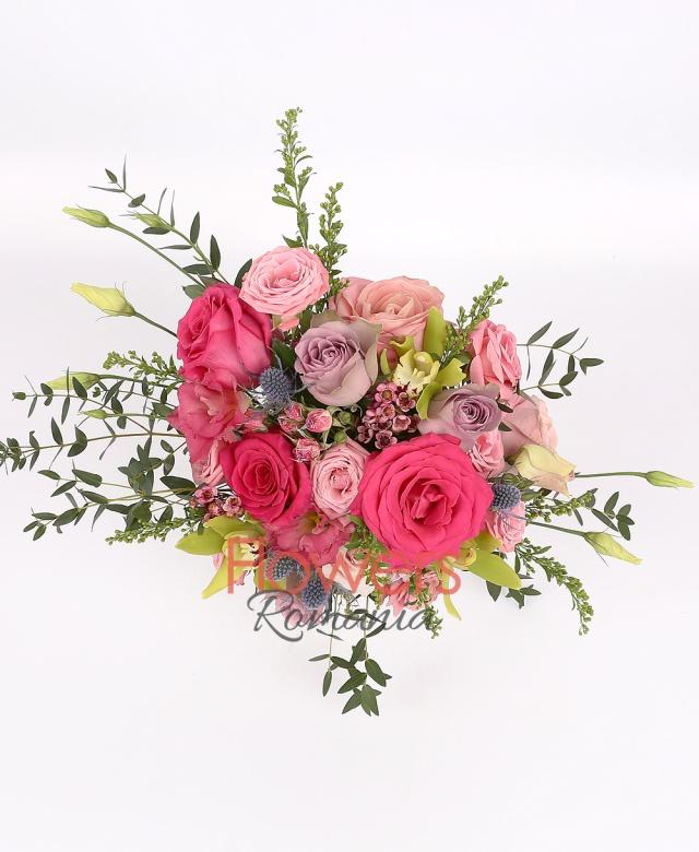 9 roses, 3 pink miniroze, 2 pink lisianthus, 1 green cymbidium, 1 eryngium, waxflower, solidago, greenery