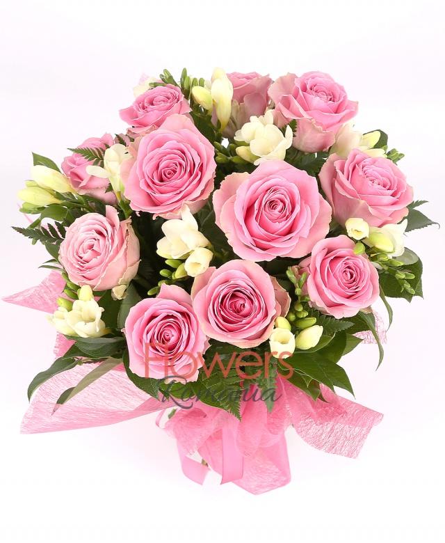 11 pink roses, 10 white freesias, greenery