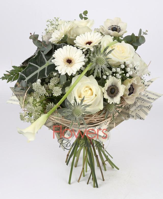 5 white roses, 3 white gerbera, 5 white ranunculus, 1 white cala, 1 eryngium, astrans, gypsophila, greenery