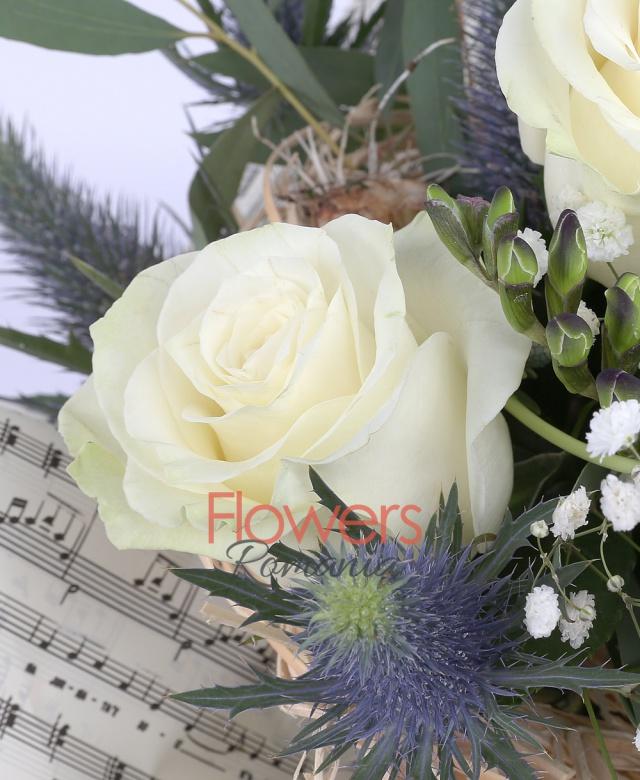 5 white roses, 4 purple freesia, 4 eryngium, greenery and decorations