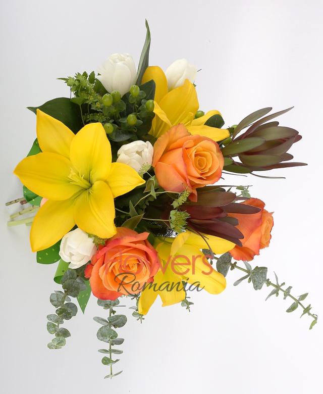 3 orange roses, 5 white tulips, 2 yellow lilies, 2 leucadendron 2 green hypericum, greenery