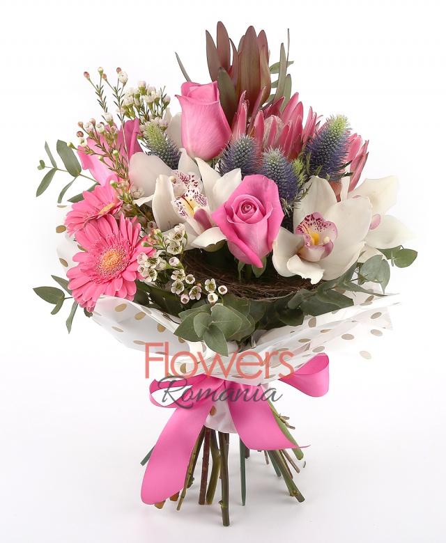 5 pink roses, 2 eryngium, 1 white cymbidium, 2 proteea, 2 pink gerbera, 2 leucadendron, greenery