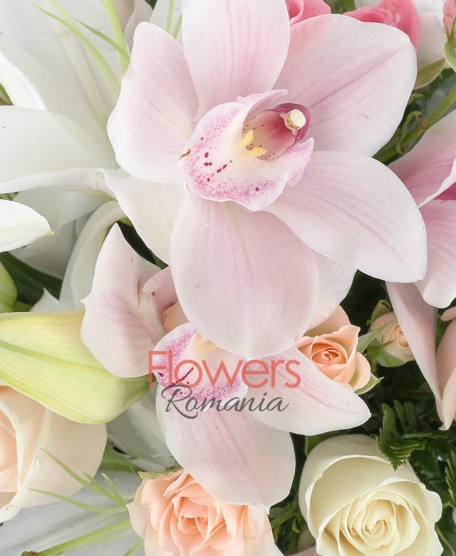 2 white lilies, 3 cream roses, 2 white roses, 5 cream miniroze, 1 pink cymbidium, greenery