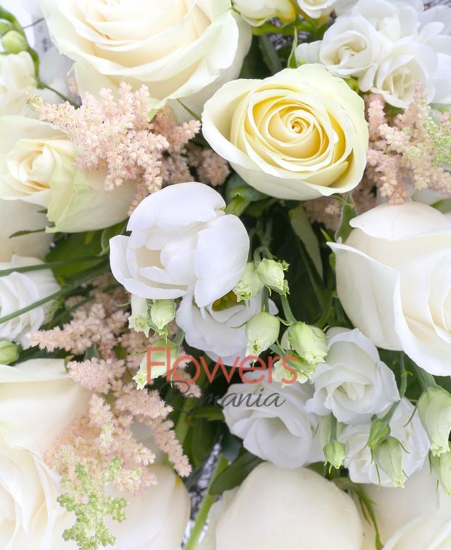 9 white roses, 7 white lisianthus, 10 white tulips, 10 white freesias, greenery