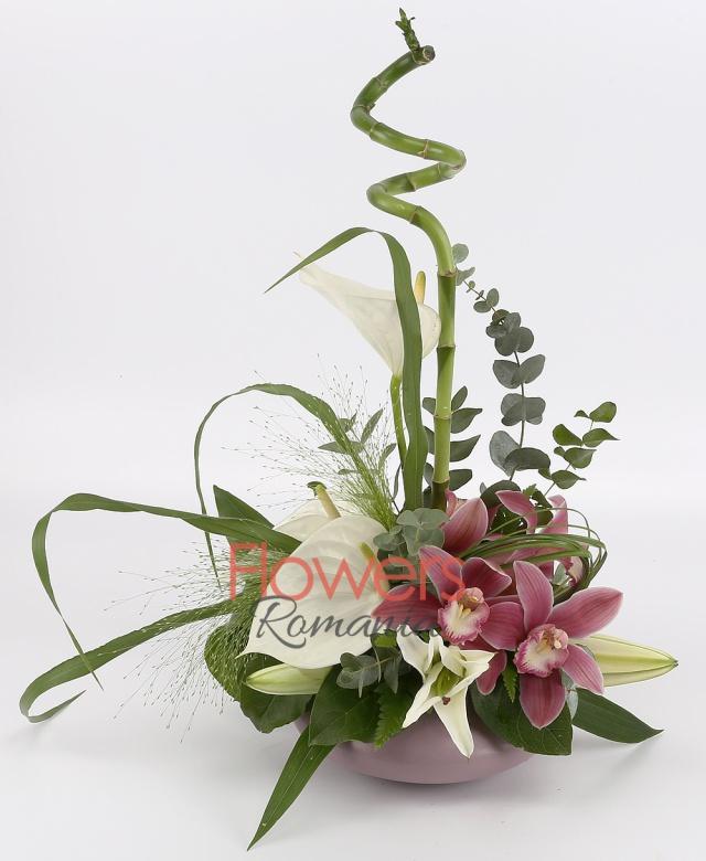 3 white anthurium, 1 purple cymbidium, 1 white lily, greenery