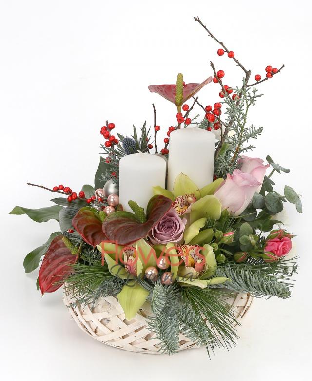 4 anthuriums, 3 purple roses, pink miniroses, green cymbidium, 1 eryngium, white lisianthus, holly, candles, globes, greenery
