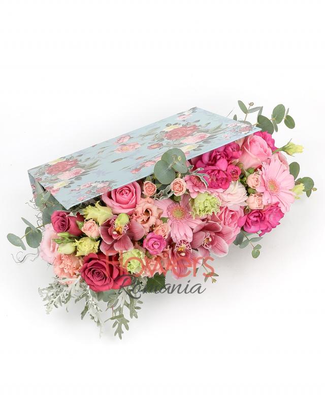 5 pink roses, 2 pink gerbera, 5 cyclam freesias, 3 pink miniroses, 3 pink lisianthus, pink cymbidium, greenery