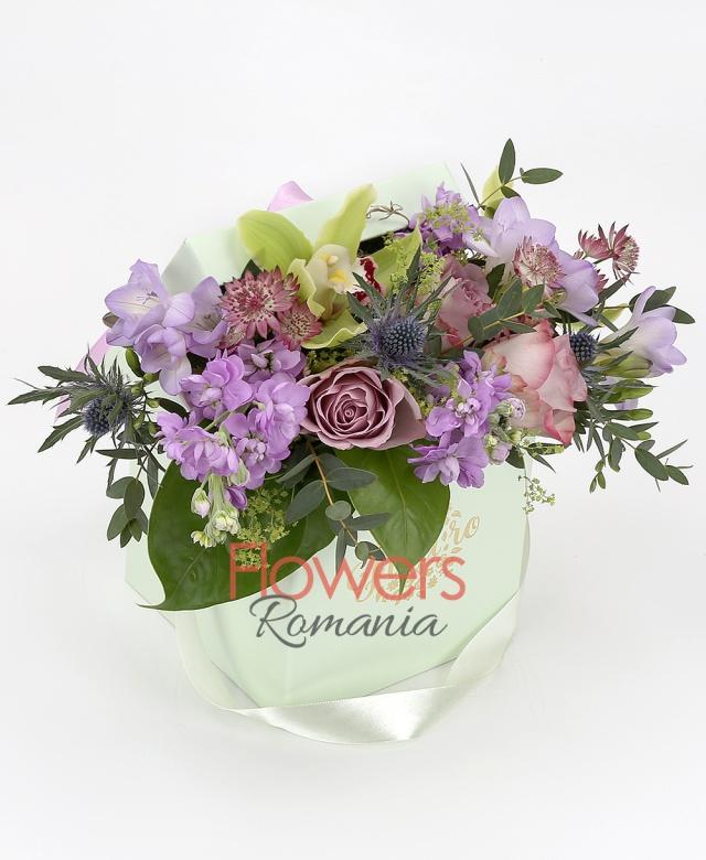 3 purple roses, 3 purple matthiola, 3 purple freesias, 2 eryngium, green cymbidium, greenery