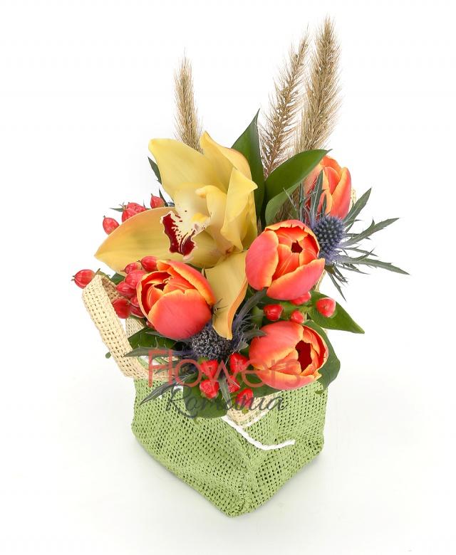 5 orange tulips, 2 red hypericum, 1 eryngium, yellow cymbidium, greenery