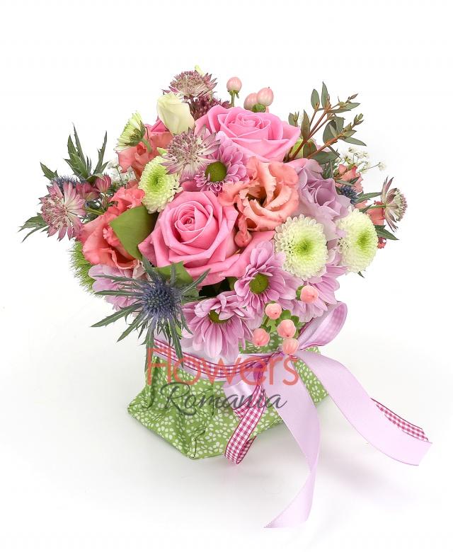 3 pink roses, 2 purple roses, 2 pink lisianthus, 3 pink hypericum, 1 pink chrysanthemum, 1 white santini, 1 eryngium, greenery