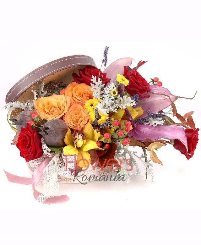 3 orange roses, 4 red roses, 3 anthurium, 1 yellow cymbidium, 3 red hypericum, 2 yellow santini