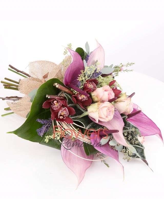 4 pink roses, 7 purple anthurium, 2 white trachelium, 1 burgundy cymbidium , lavender, waxflower, curly, greenery
