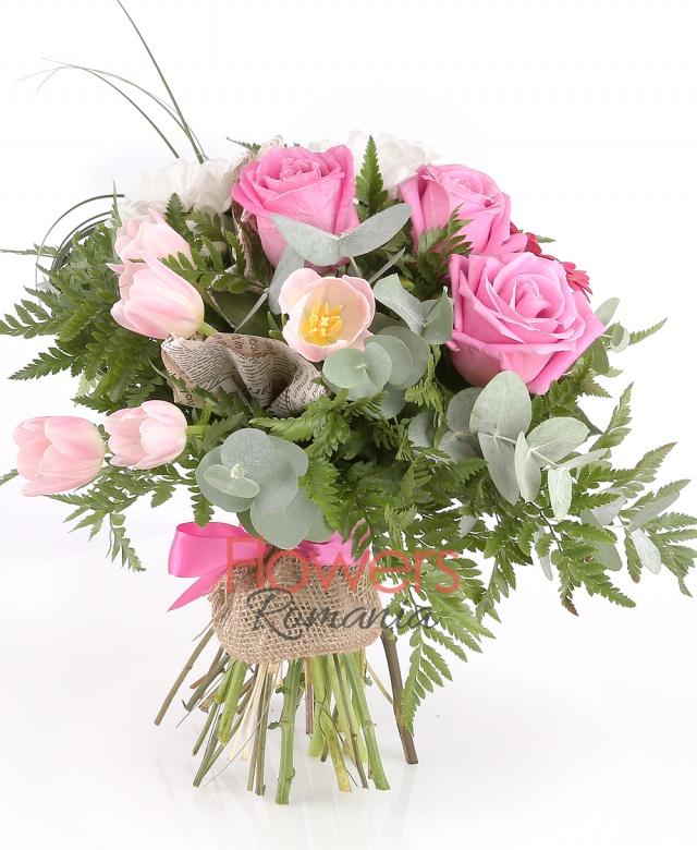 3 pink roses, 3 pink gerbera, 5 pink tulips (in season), 2 chrysanthemums, greenery
